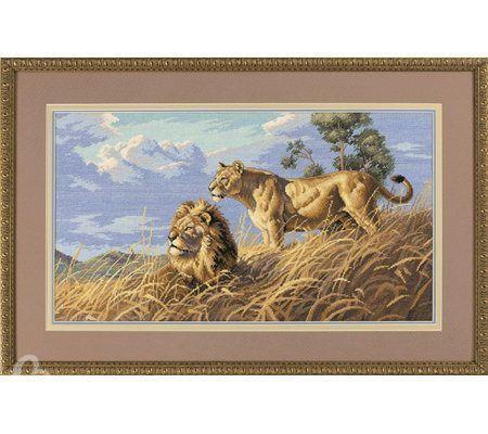 Золотистый отлив шерсти львов приятно сочетается с высохшей под знойным солнцем травой и великолепно оттеняется...